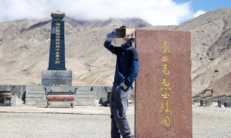 A travel blogger who posed next to the tombstone of Chinese martyrs who died in the Galwan Valley border clash had his account shut down on Chinese social media for showing no respect to the heroes. Photo: Dazhong Daily