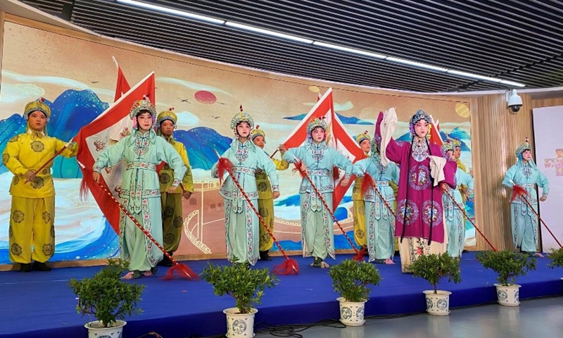Students from Siyuan Junior High School perform Peking Opera at the camp's opening ceremony in Shanghai on Monday. Photo: Yu Xi/GT
