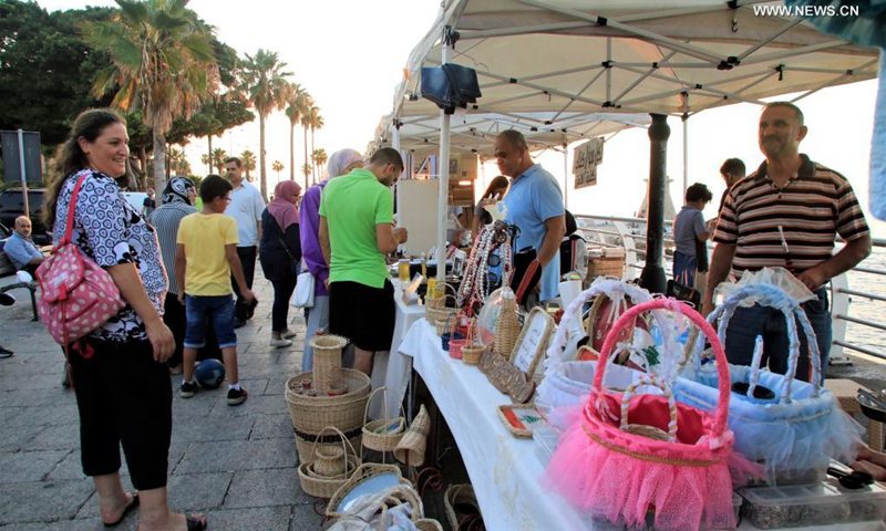 People visit a popular fair of handicrafts and local products at Beirut Corniche in Beirut, Lebanon, on July 18, 2021. (Photo: Xinhua)