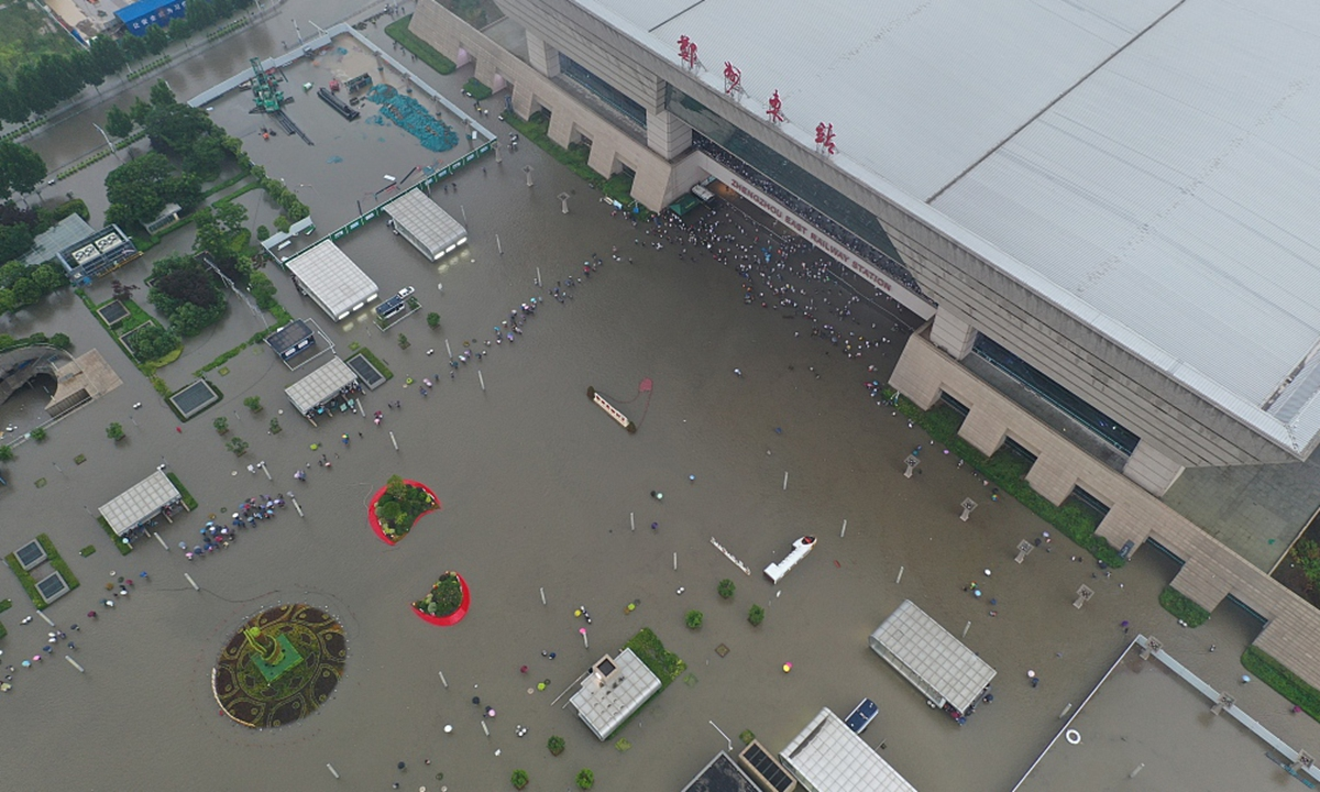 Passengers are stranded at Zhengzhou East Railway Station on July 20, 2021 due to the heavy rainfall. Photo: CFP