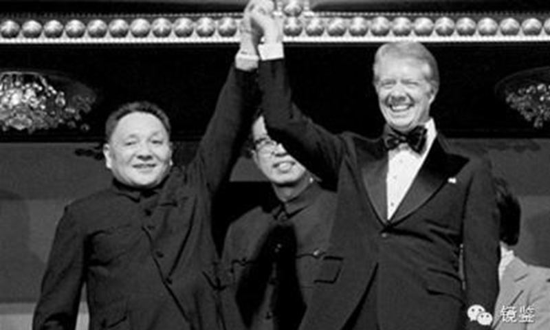 Deng Xiaoping and Jimmy Carter meet the press at the White House Rose Garden after their talks.