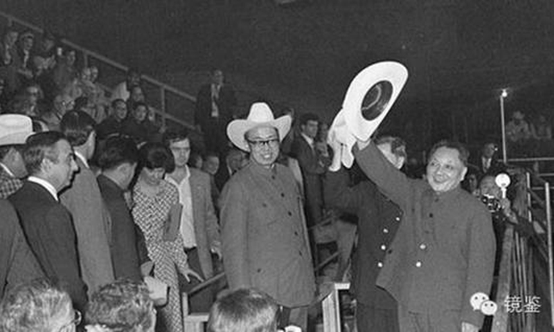 Deng Xiaoping waves a cowboy hat at the audience.