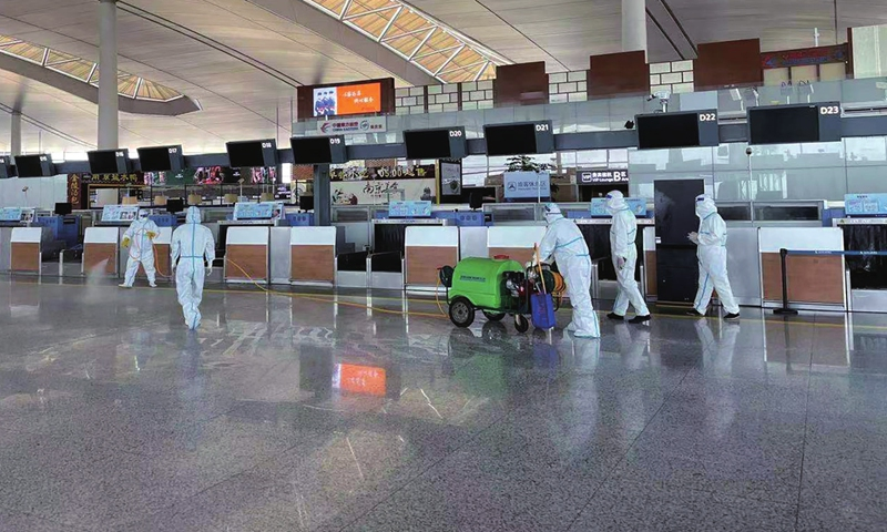 Staff members carry out sterilization work at the Terminal 2 of Nanjing Lukou International Airport in Nanjing, East China's Jiangsu Province on Wednesday after 17 airport workers tested positive for the COVID-19. Photo: Xinhua