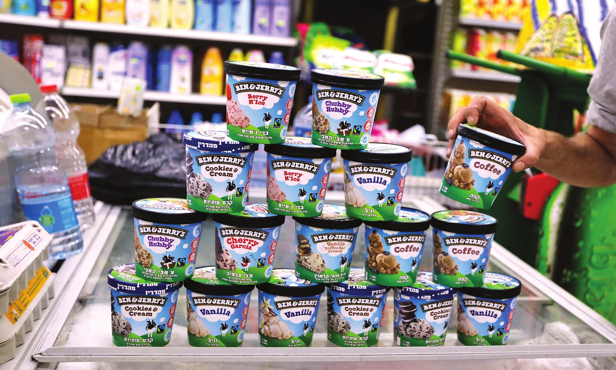 A man buys Ben & Jerry's ice cream in Jerusalem on Tuesday. US ice cream-maker Ben & Jerry's announced on Monday they would stop selling their ice cream in the occupied Palestinian territories, saying its sale