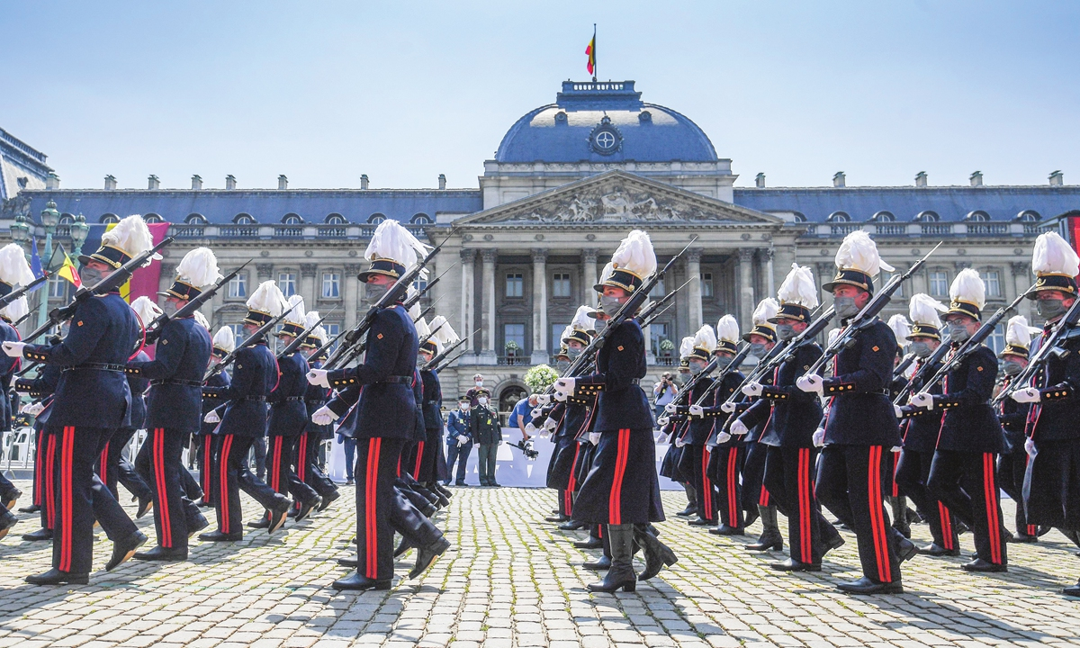 Cadets of a military school platoon pass by the Royal tribune during the National Parade for Belgian National Day on Wednesday in Brussels, Belgium. Photo:VCG