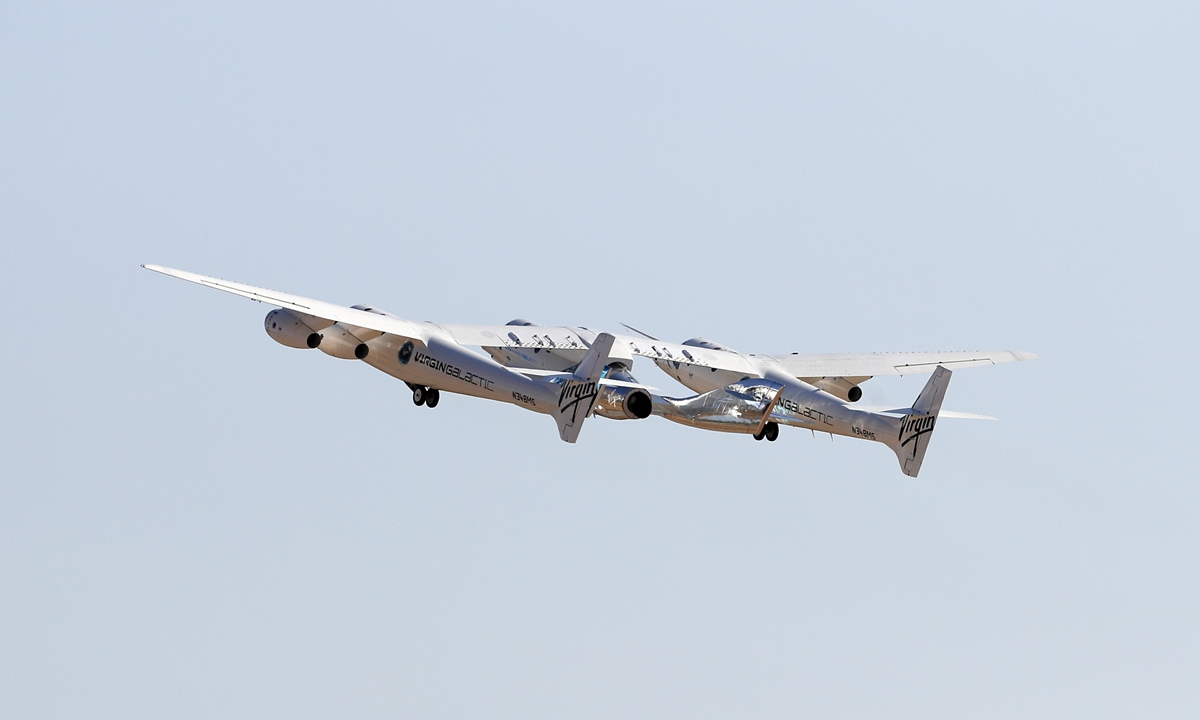 The rocket plane carrying Virgin Galactic founder Richard Branson and other crew members flies toward space on July 11. Photo: VCG