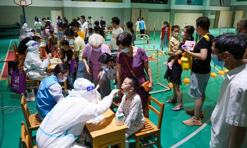 Medical workers take swab samples from residents for COVID-19 test at a testing site in Nanjing, east China's Jiangsu Province, July 21, 2021.Photo:Xinhua