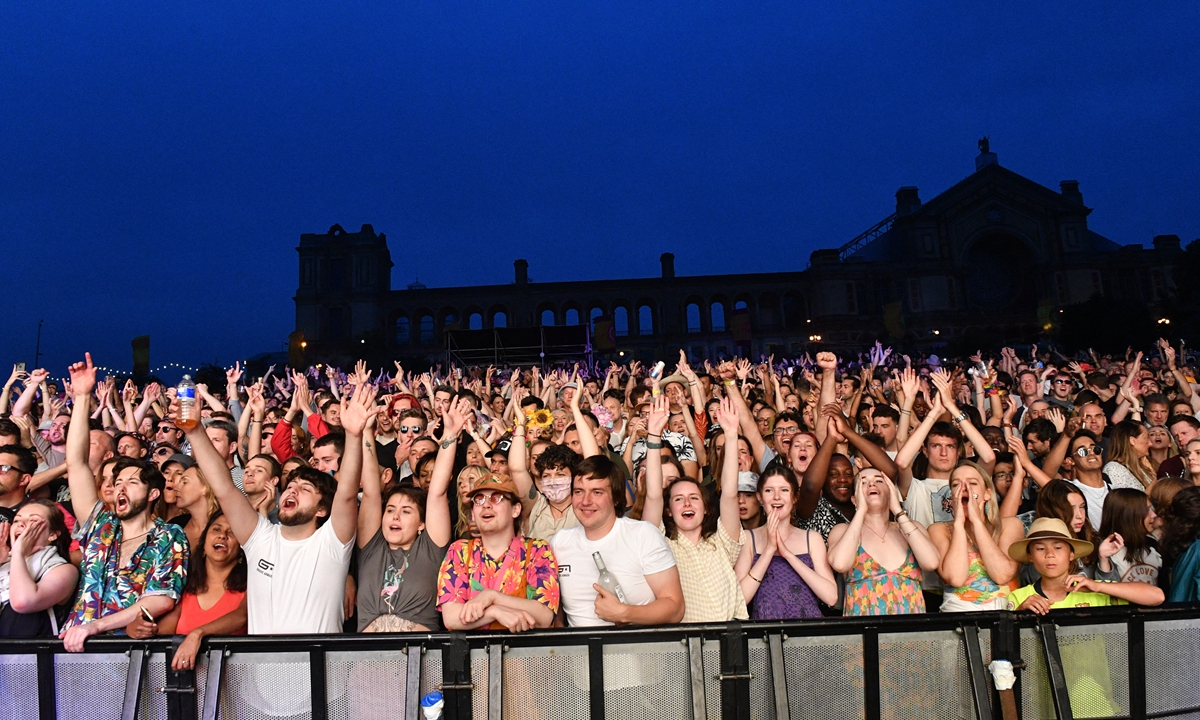 Festival-goers attend the Kaleidoscope Festival in Alexandra Palace Park in London on Saturday.  Photo: AFP