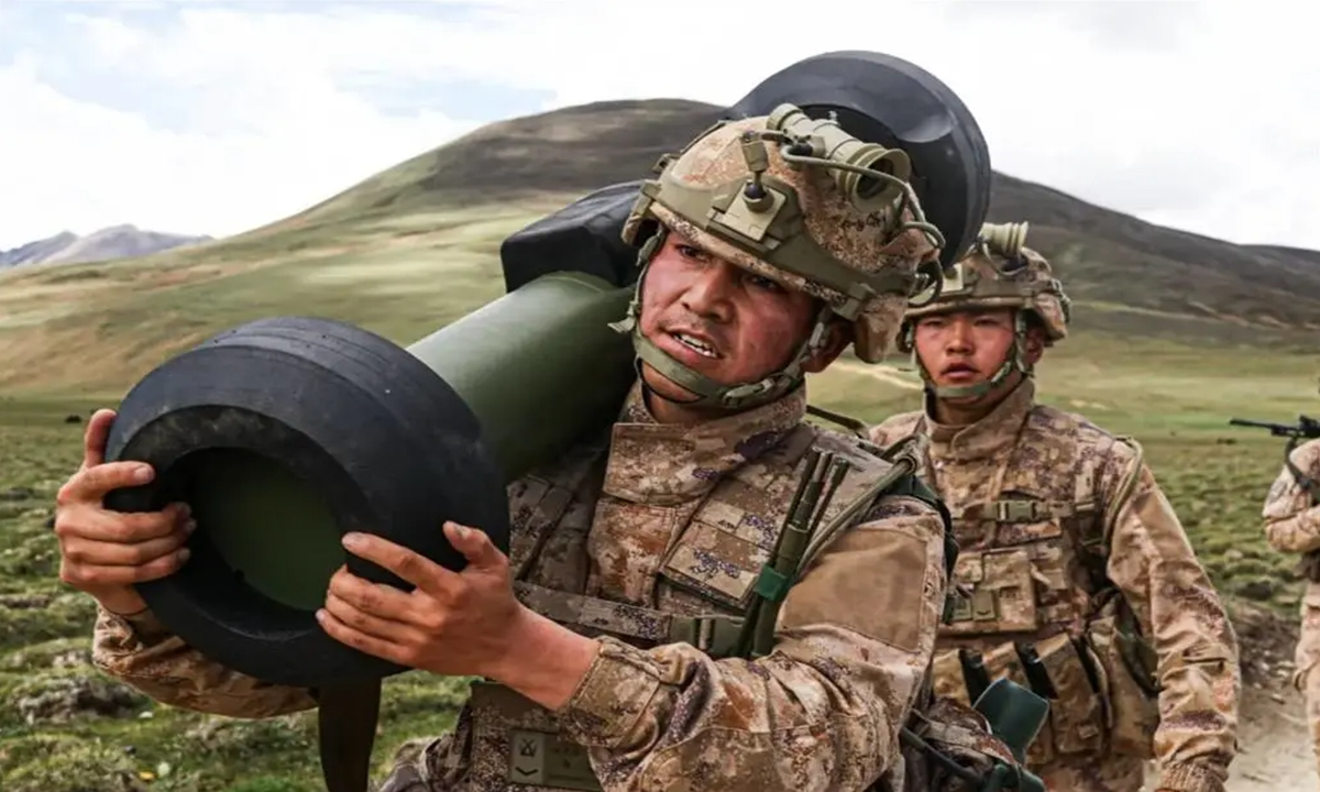 A soldier attached to a brigade affiliated with the #PLA #Tibet Military Command marches in training exercises, carrying a HJ-12 man-portable anti-tank missile, deep in Southwest China's plateau region in July 2021. Photo: Screenshot from the WeChat account of the PLA Tibet Military Command