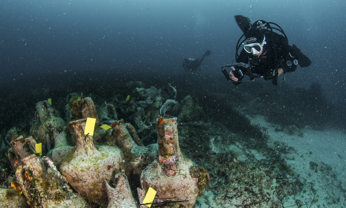 Divers explore the ruins of an ancient shipwreck on the Aegean island of Alonissos, Greece on April 9, 2019. Photo: AFP