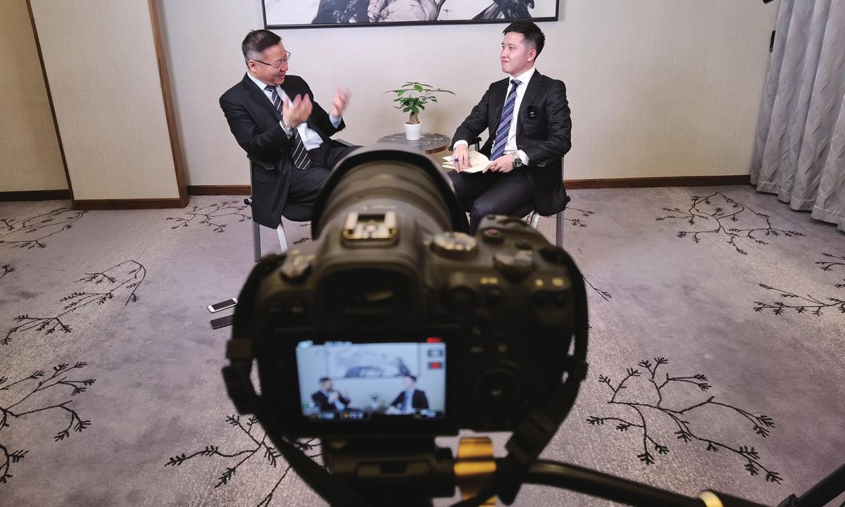 Global Times reporter Yang Sheng (right) interviews Professor Zhang Weiwei (left). Photo: Yang Ruoyu/GT