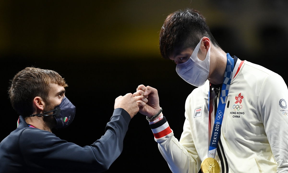 Cheung Ka Long (right) of China's Hong Kong and Daniele Garozzo of Italy react during the ceremony for the men's foil individual gold medal match at the Tokyo 2020 Olympic Games in Tokyo, Japan, on Monday. Photo: Xinhua