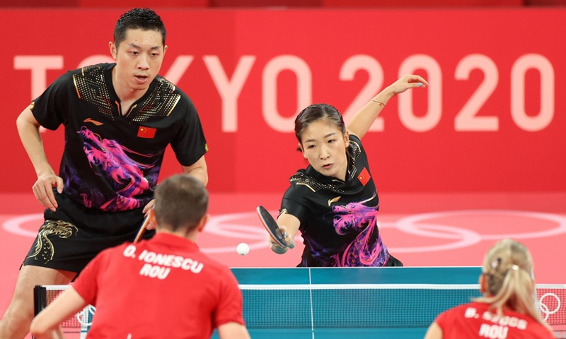 Xu Xin (L, top)/Liu Shiwen (R, top) of China compete during table tennis mixed doubles quarterfinal at the Tokyo 2020 Olympic Games in Tokyo, Japan, July 25, 2021. Photo: Xinhua