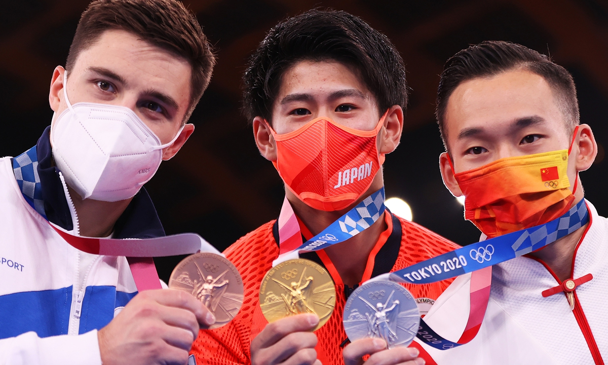 Bronze medalist Nikita Nagornyy of Team ROC, gold medalist Daiki Hashimoto of Team Japan and silver medalist Ruoteng Xiao of Team China pose with their medals during the Men's All-Around Final on day five of the Tokyo 2020 Olympic Games at Ariake Gymnastics Centre on July 28, 2021 in Tokyo, Japan.