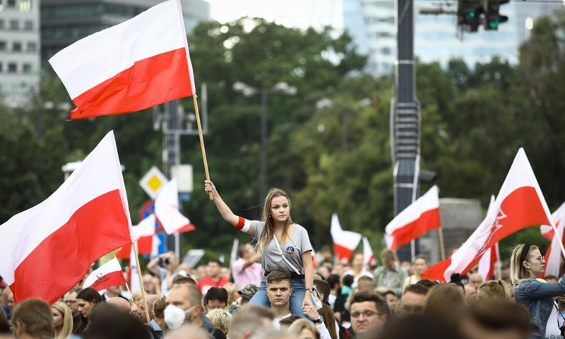 A girl holds a Polish national flag as people gather to commemorate the Warsaw Uprising in Warsaw, Poland, on Aug. 1, 2021. On Aug. 1, 1944, the Polish underground resistance, led by the Polish Home Army, began a major military operation to liberate Warsaw from Nazi occupation. The uprising, which lasted 63 days, was the largest military effort of any European resistance against Nazi Germany. (Photo by Jaap Arriens/Xinhua)