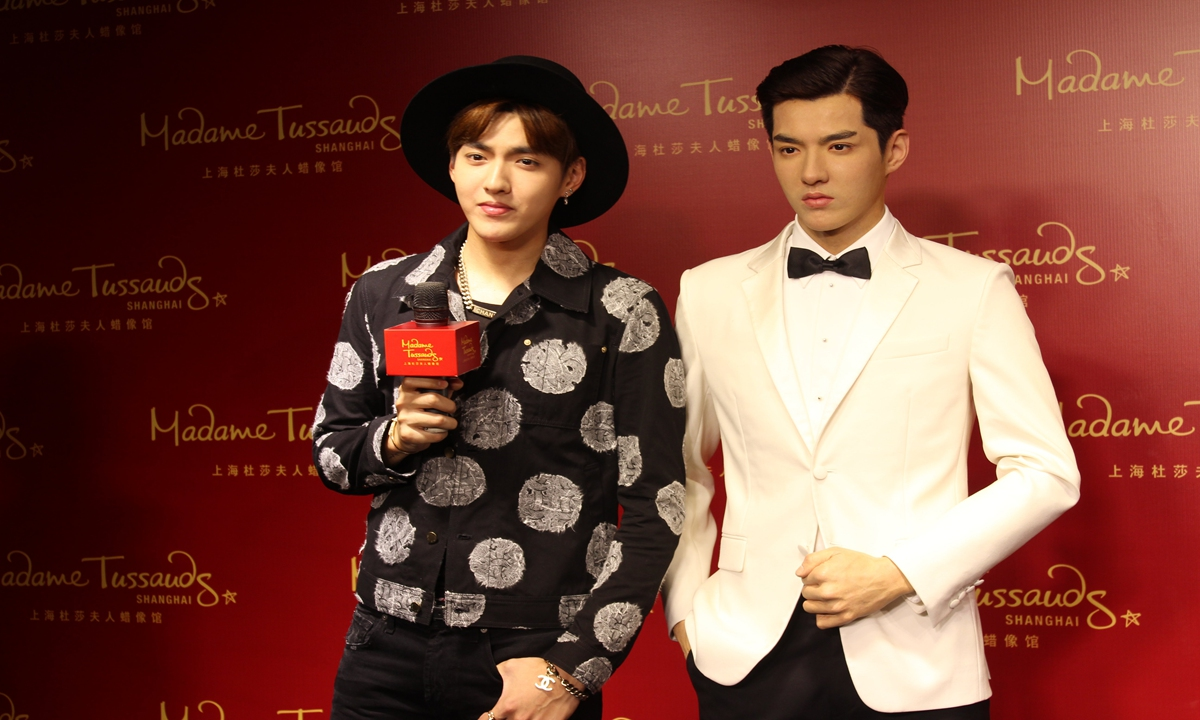 Kris Wu posed a picture with his wax figure at Madame Tussauds Shanghai in 2015 when his wax figure was revealed. Photo: VCG