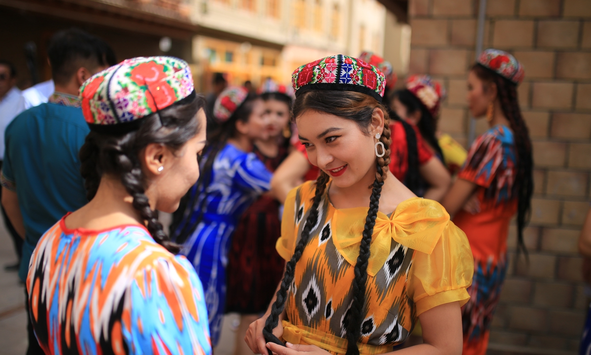 Two girls dress up for the Corban Festival in Hotan Prefecture. Photo: Fan Lingzhi/GT