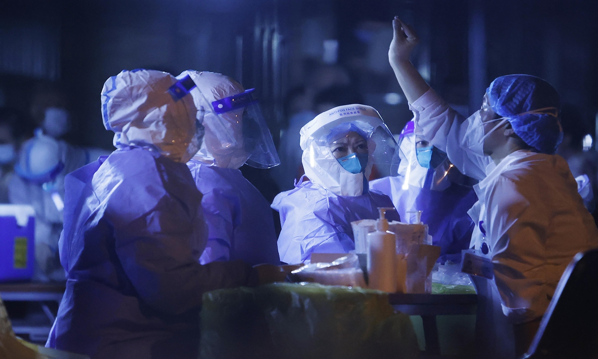 Medical staff members work at the Pudong airport on Monday night. Photo: VCG