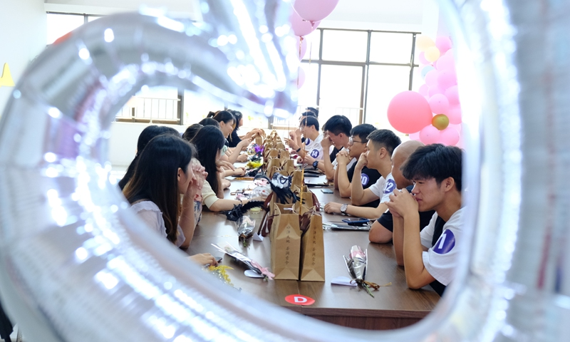 Young people at a Qixi matchmaking event in Hefei, East China's Anhui Province in August 2020