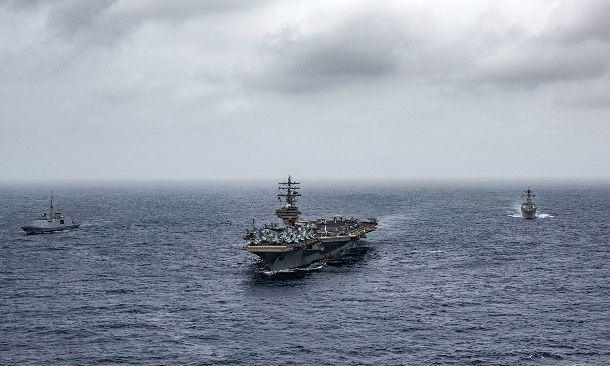 This handout photo courtesy of US Navy, made available on July 24, shows (left to right) French navy frigate <em>FS Languedoc</em>, aircraft carrier <em>USS Ronald Reagan</em>, and guided-missile destroyer <em>USS Halsey</em> steaming in formation in the Arabian Sea. Photo: AFP