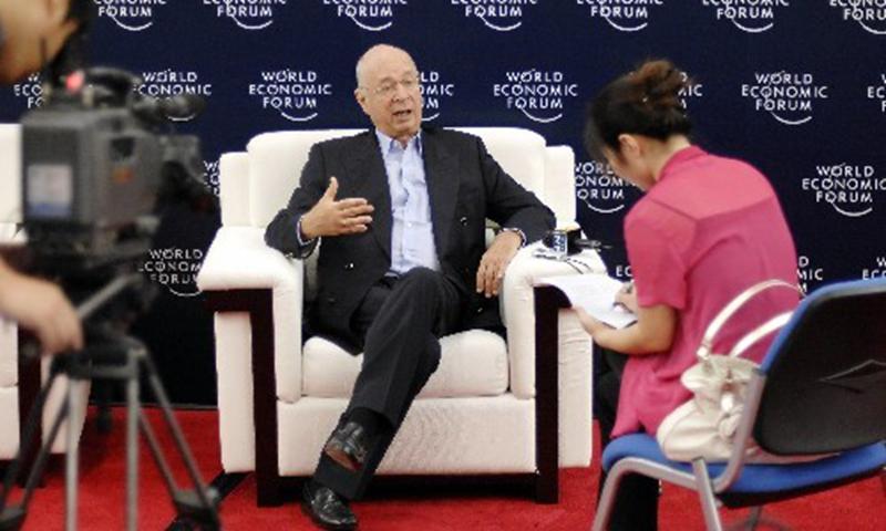 Klaus Schwab being interviewed by Xinhua News Agency