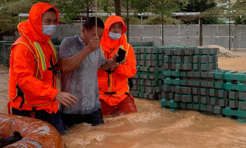 Rescuers evacuate a citizen to a safe area in Dongyao Village of Xiamen, southeast China's Fujian Province, Aug. 5, 2021. Typhoon Lupit made its second landfall on Thursday in Fujian Province, bringing heavy downpours and forcing the evacuation of thousands. The local government has initiated an emergency response to flood and waterlogging amid torrential rains brought by Lupit.Photo:Xinhua