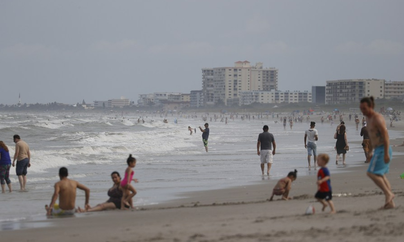 People lounge on the beach in Cocoa Beach, Florida, the United States, on May 28, 2020. Photo:Xinhua