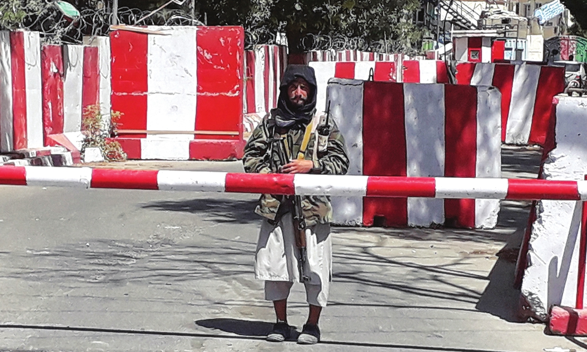 A Taliban fighter stands at the entrance of the police headquarters in Ghazni, Afghan on Thursday, as Taliban move closer to Kabul, Afghan capital, after taking Ghazni. Photo: AFP