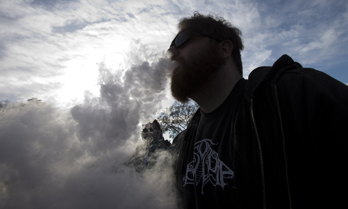 A demonstrator vapes during a rally outside of the White House to protest the proposed vaping flavor ban in Washington DC on November 9, 2019.  Photo: AFP
