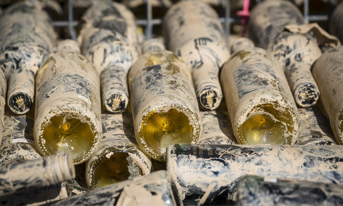 Wine bottles covered in mud Photo: AFP