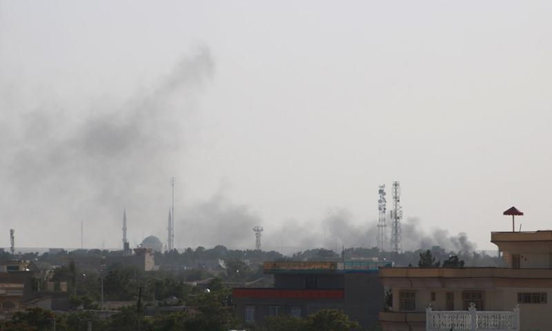 Photo taken on Aug. 6, 2021 shows smoke rising during gun fights in Shiberghan, capital of Jawzjan Province, Afghanistan. (Photo: Xinhua)