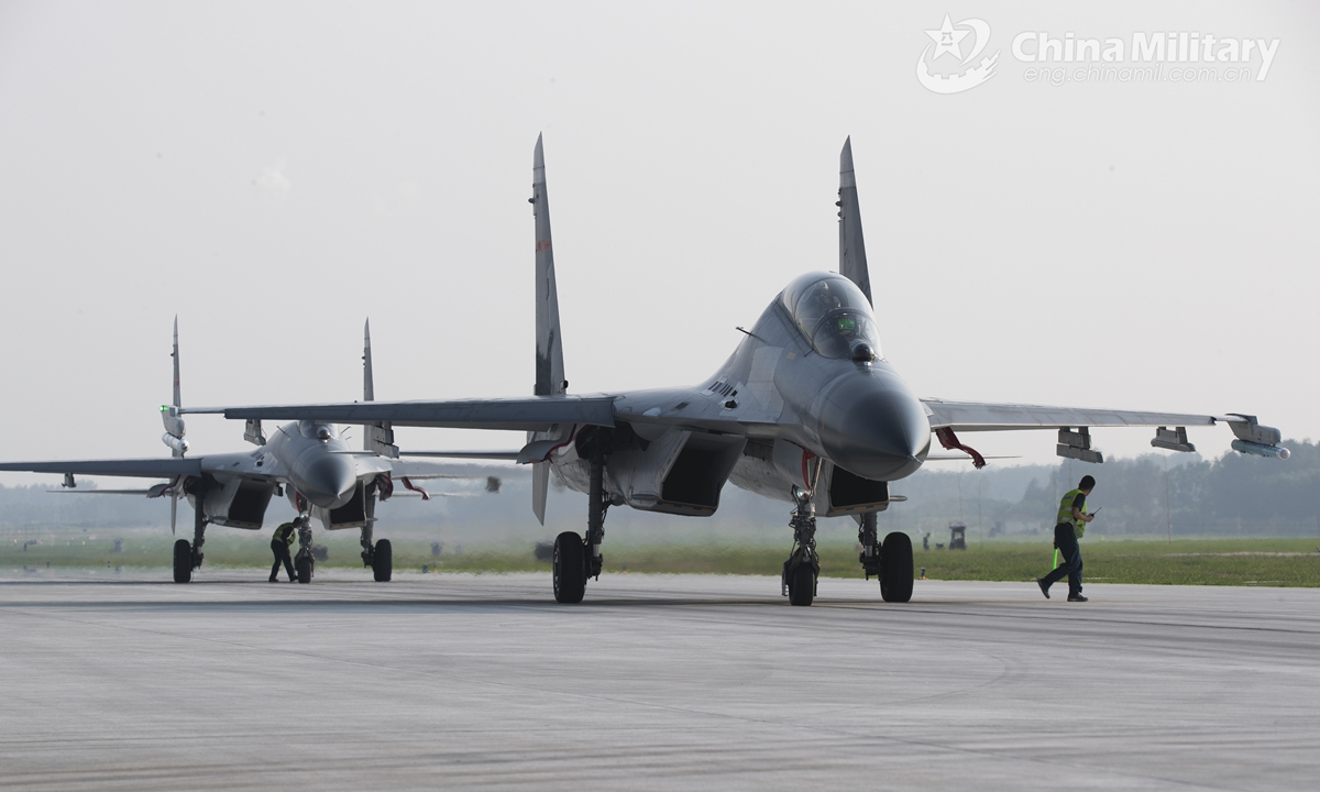 Fighter jets attached to an aviation brigade of the air force under the PLA Eastern Theater Command taxi in formation to the servicing depot for inspections prior to a flight training exercise on July 31, 2021.Photo:China Military