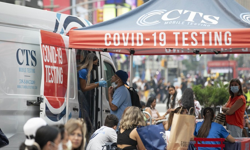 A man receives COVID-19 test at a mobile testing site in Times Square, New York, the United States, on July 20, 2021. (Xinhua/Wang Ying)