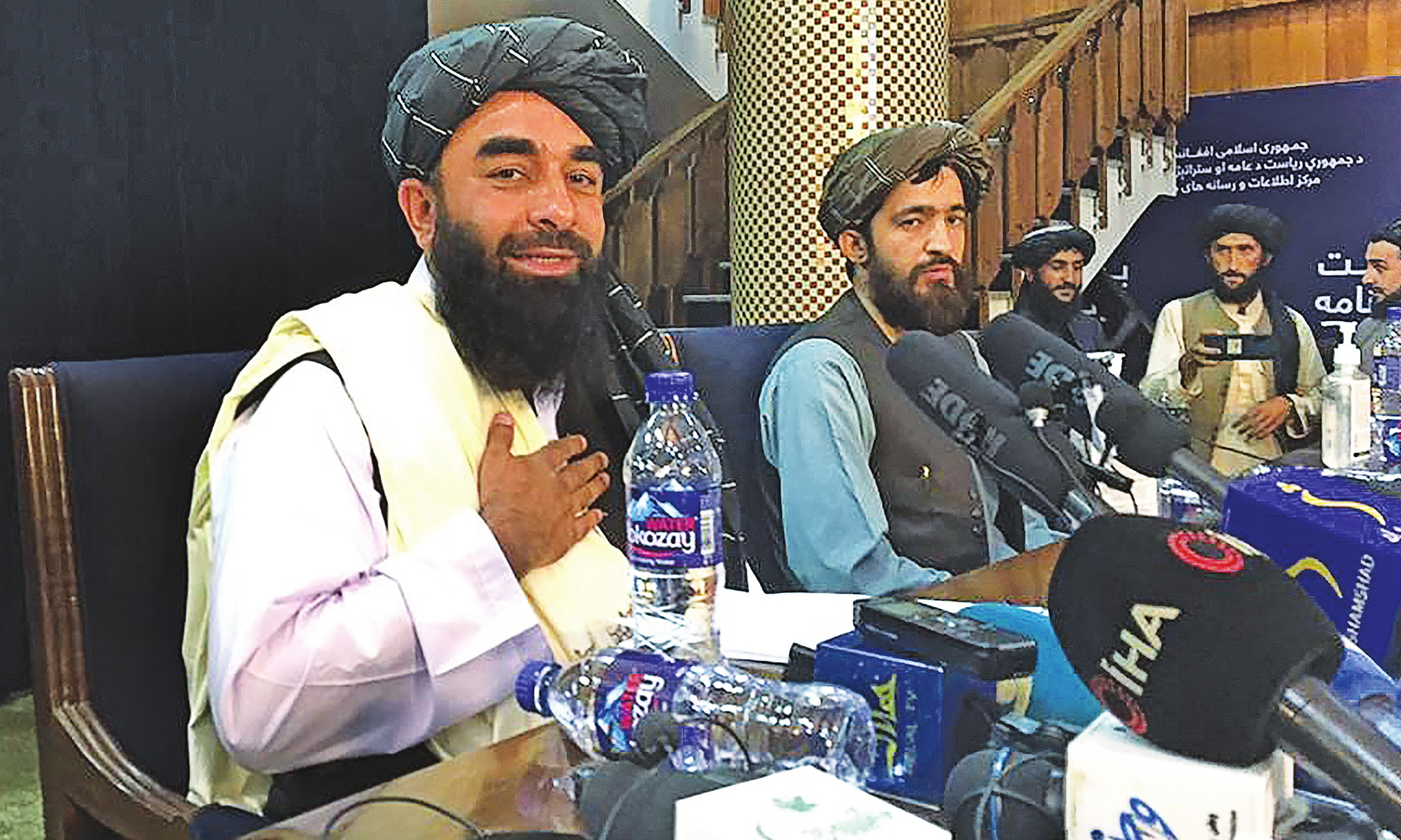 Taliban spokesperson Zabihullah Mujahid (left) gestures as he arrives to hold the first press conference in Kabul on Tuesday following the Taliban rapid takeover of Afghanistan. The Taliban declared that they wanted peaceful relations with other countries and would respect the rights of women within the framework of Islamic law.