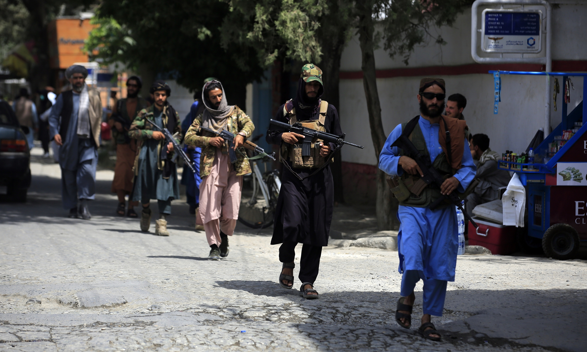 Taliban fighters patrol in the Wazir Akbar Khan neighborhood in the city of Kabul, Afghanistan on Wednesday. The Taliban declared an