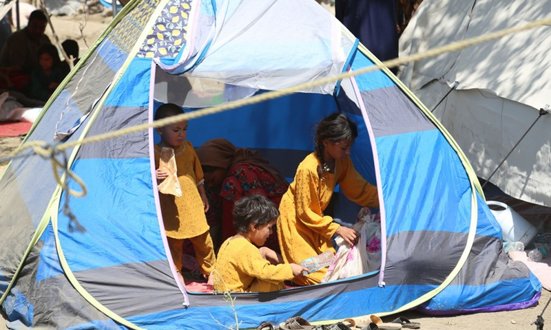 Afghan displaced children who fled from their homes during the fights take shelter in a public park in Kabul, Afghanistan, Aug. 11, 2021.(Photo: Xinhua)