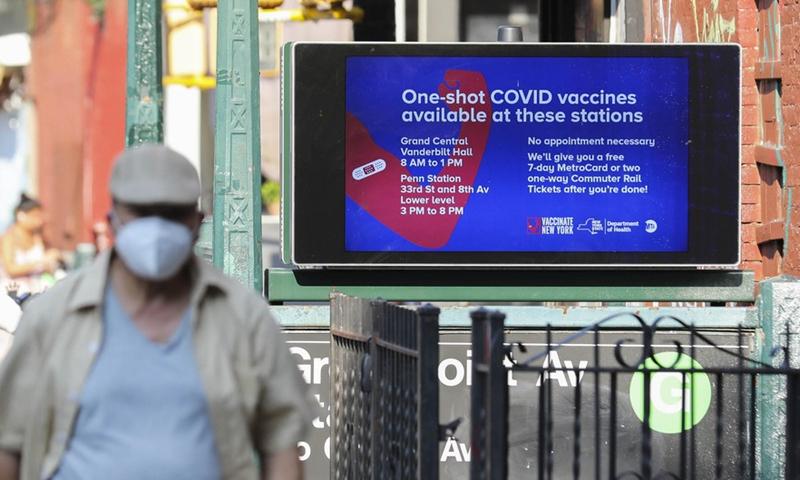 A pedestrian walks past a COVID-19 vaccine inoculation billboard in New York, the United States, July 26, 2021.Photo:Xinhua