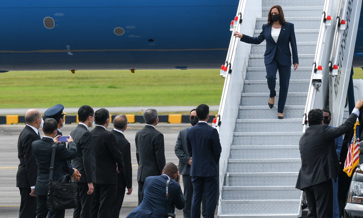 US Vice President Kamala Harris steps off Air Force Two as she arrives at Paya Lebar Base airport in Singapore on Sunday. Photo: AFP