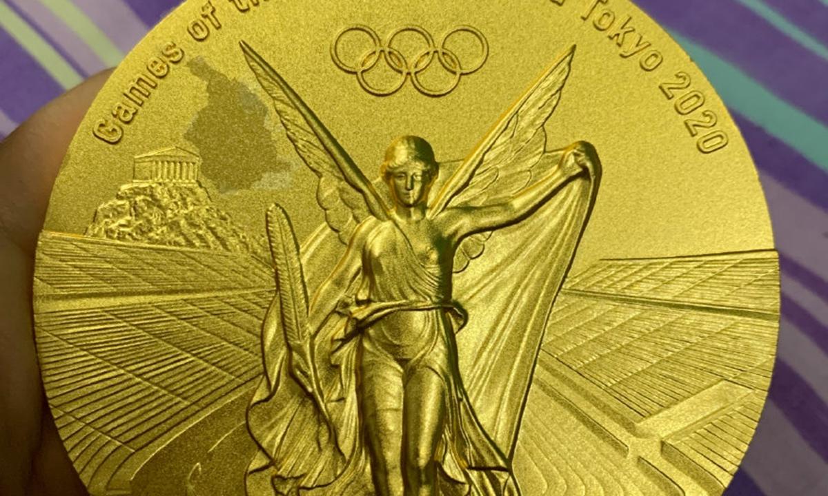 A photo of Zhu's gold medal. Photo: Sina Weibo
