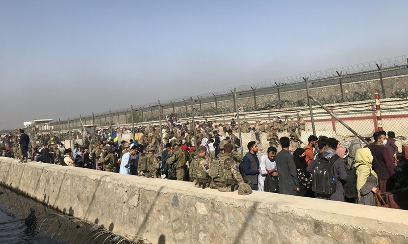 Photo taken on Aug. 22, 2021 shows foreign forces at the entering gate of Kabul airport in Kabul, Afghanistan. (Photo: Xinhua)