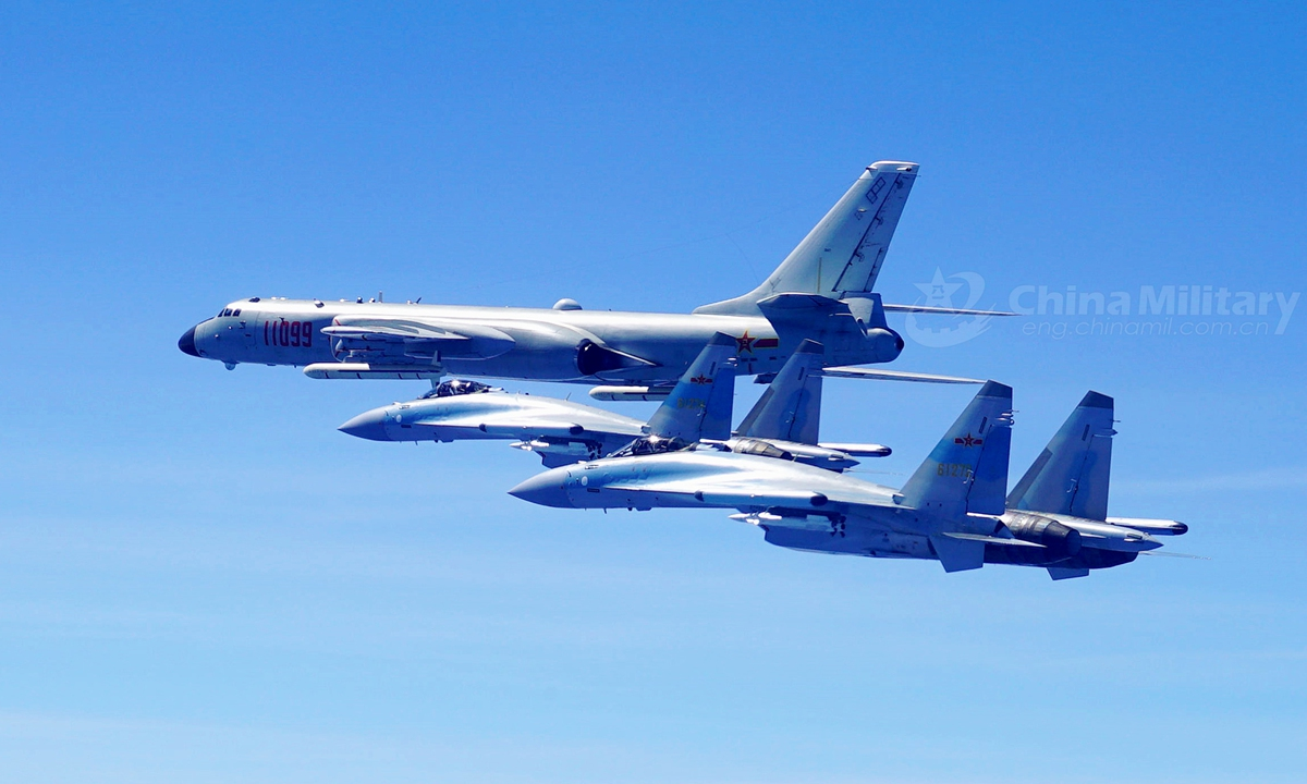 Two Su-35 fighter jets and a H-6K bomber fly in formation on May 11, 2018. The People's Liberation Army (PLA) air force conducted patrol training over China's island of Taiwan on Friday. Su-35 fighter jets flew over the Bashi Channel in formation with the H-6Ks for the first time, which marks a new breakthrough in island patrol patterns, said Shen Jinke, spokesperson for the PLA air force.Photo:China Military
