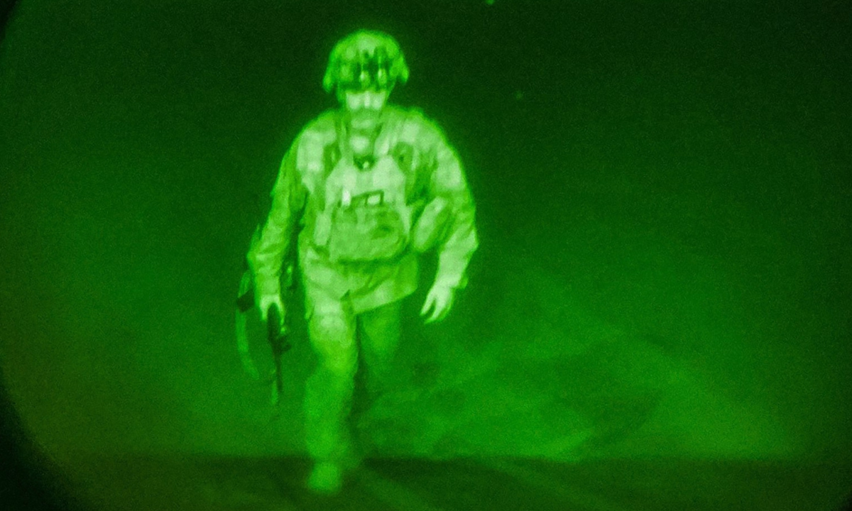 In this handout image courtesy of the US Central Command Public Affairs, Major General Chris Donahue of the US Army boards a plane at the Hamid Karzai International Airport in Kabul, Afghanistan on Monday. Donahue is the final American service member to depart Afghanistan. His departure closes the US mission to evacuate American citizens, Afghan special immigrant visa applicants, and vulnerable Afghans. Photo: AFP