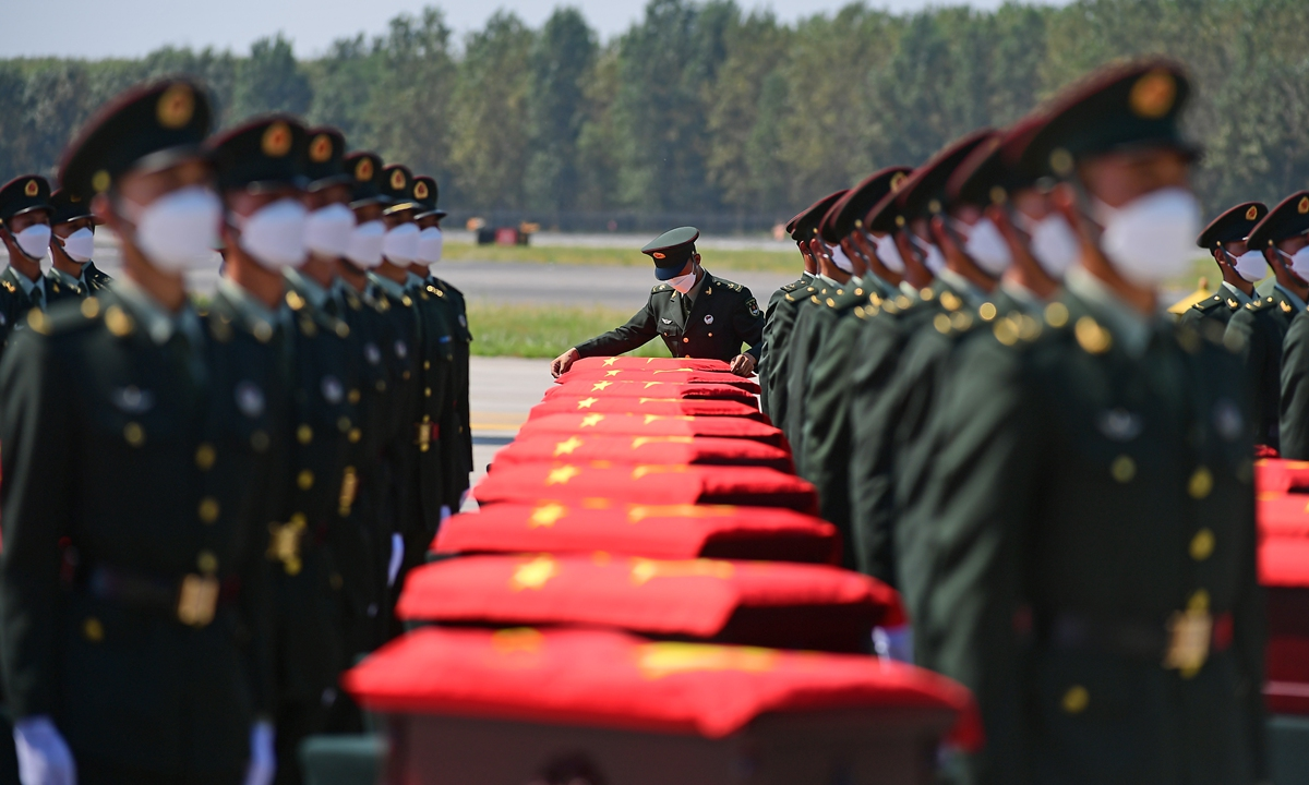 The remains of 109 Chinese People's Volunteers soldiers arrive at the Shenyang Taoxian International Airport in Northeast China's Liaoning on Thursday. Photo: cnsphoto