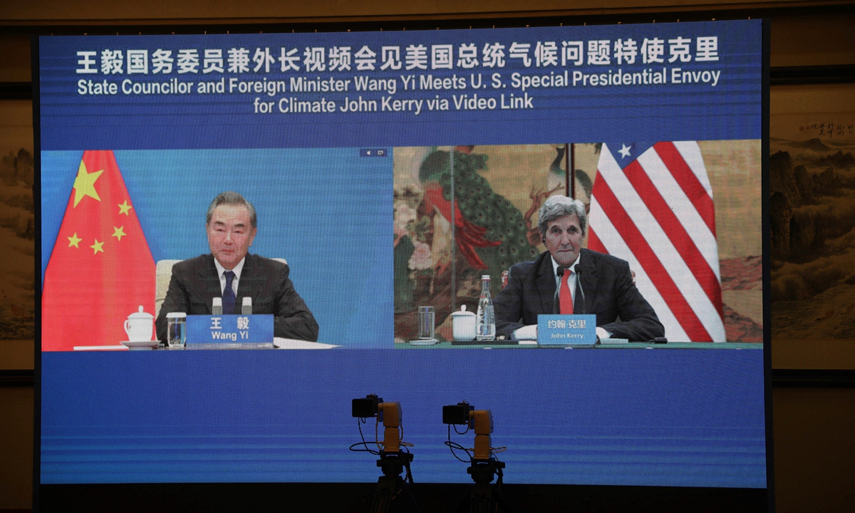 Chinese State Councilor and Foreign Minister Wang Yi meets with the US Special Presidential Envoy for Climate John Kerry via video link on Wednesday. Photo: AFP