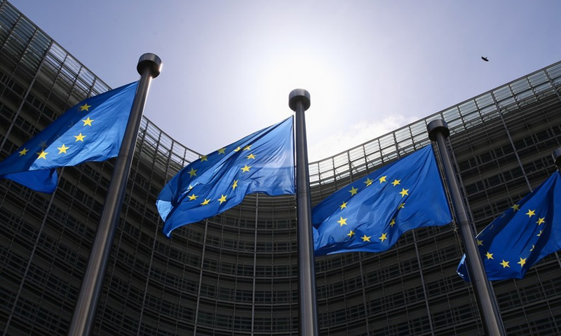 Flags of the European Union fly outside the EU headquarters in Brussels, Belgium, May 21, 2021. (Xinhua/Zheng Huansong)
