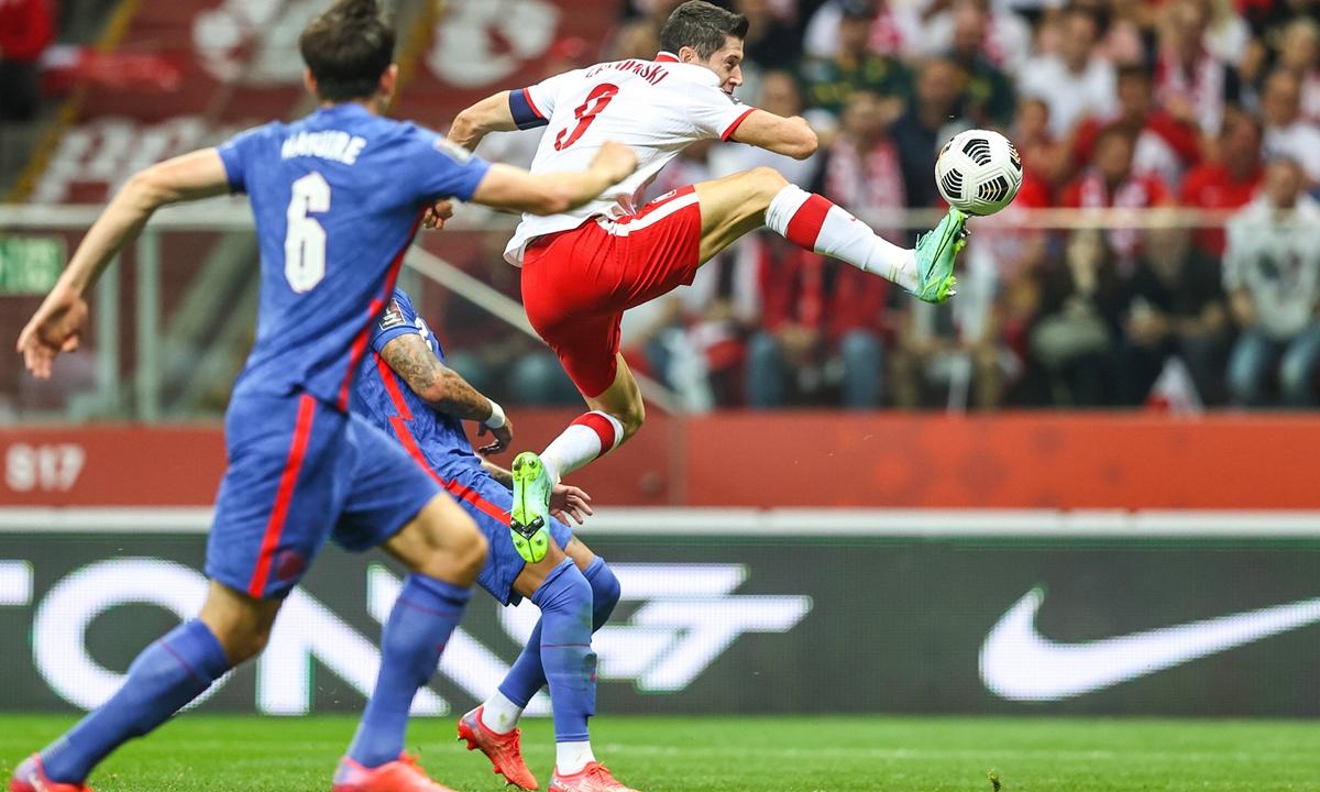 Poland forward Robert Lewandowski reaches for the ball against England in Warsaw, Poland on Wednesday. Photo: VCG
