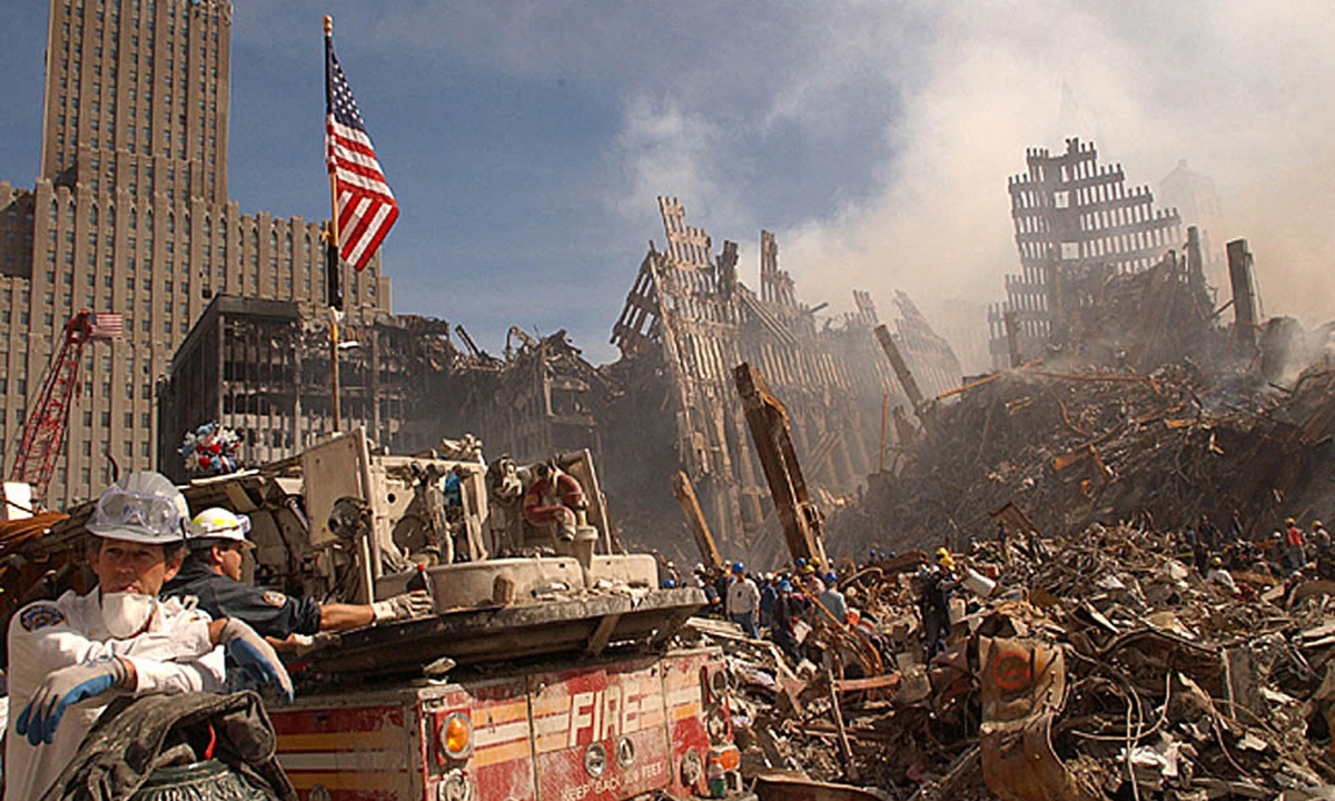 In this photo obtained 18 September 2001 from the Federal Emergency Management Agency (FEMA), firefighters and Urban Search and Rescue workers battle smoldering fires as they search for survivors at the ruins of the World Trade Center in New York 13 September 2001. Photo: AFP