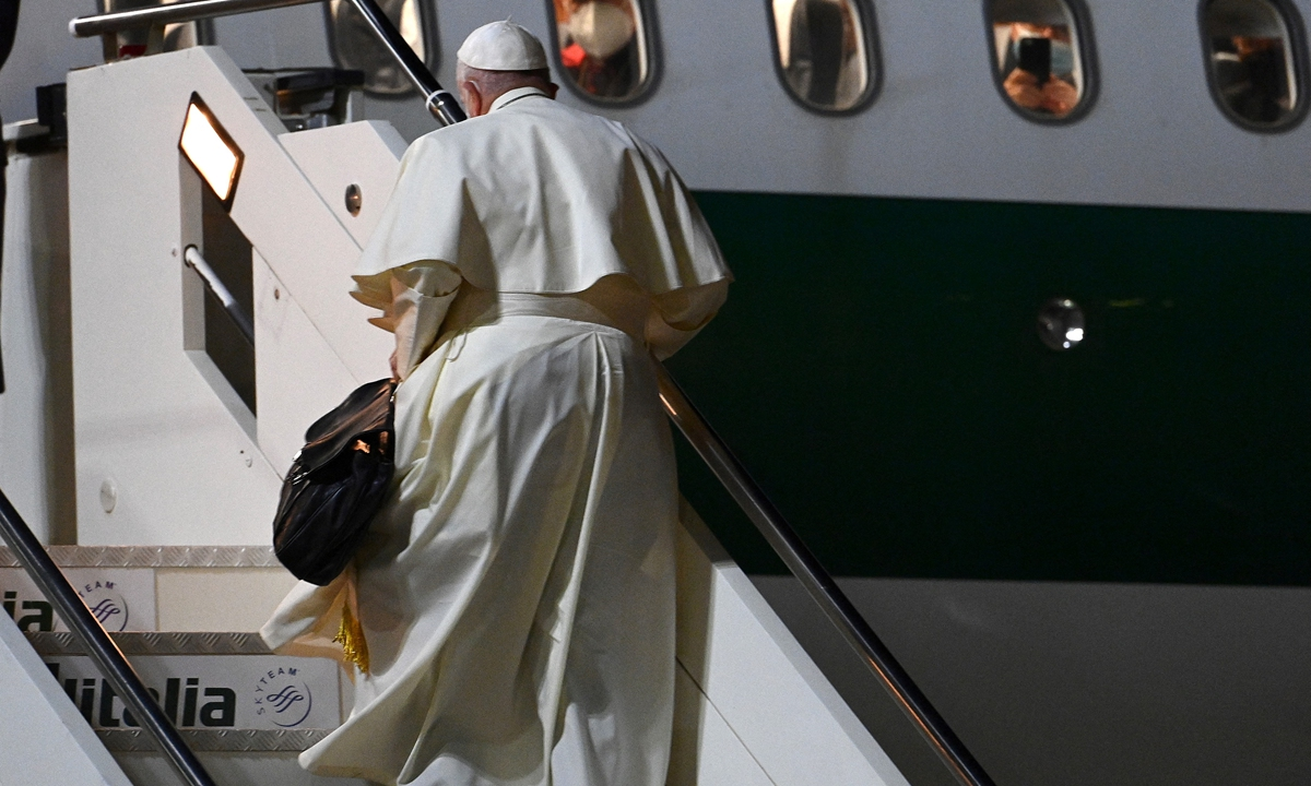 Pope Francis boards a plane as he departs for Budapest and Slovakia on Sunday at Rome's Fiumicino international airport. Photo: AFP