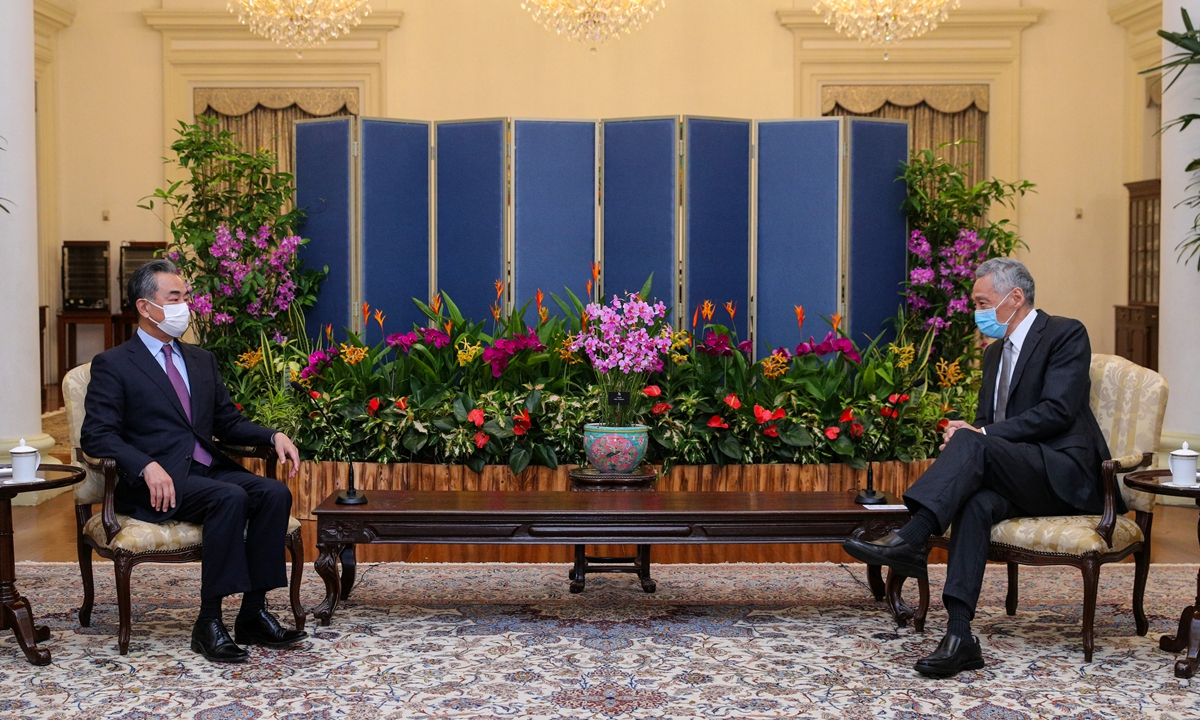 Visiting Chinese State Councilor and Foreign Minister Wang Yi meets with Singapore Prime Minister Lee Hsien Loong at the Istana on Tuesday. Photo: AFP