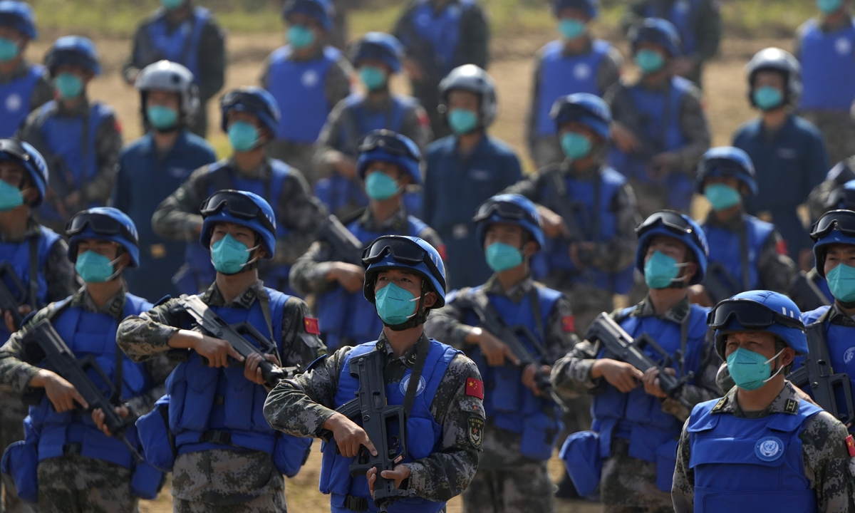 Chinese United Nations Peacekeeping Forces take part in the Shared Destiny 2021 joint training operation in Queshan county, Central China's Henan Province, on Wednesday. Peacekeeping troops from China, Thailand, Mongolia and Pakistan participated in the 10-day exercise that included medical evacuation and epidemic control drills. Photo: VCG